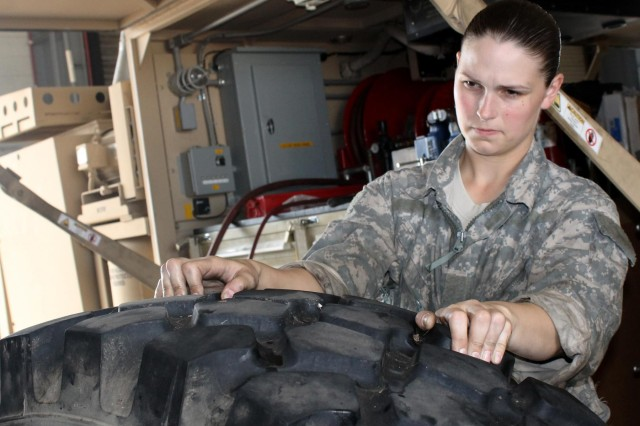 Spc. Tiffany Willand, light-wheeled mechanic serving with the 3rd IBCT, prepares to mount a tire on a M978A2 Army fuel truck Oct. 3, 2013, at the Mansfield Motorpool on Fort Knox, Ky. Willand is helping pave the way for future women aspiring to be military mechanics.