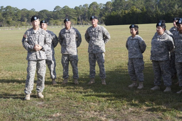 """Col. Scott A. Jackson, commander for 2nd Armored Brigade Combat Team, 3rd Infantry Division, gave thanks to the Soldiers for continuing to serve in the U.S. Army and to the nation, during a mass re-enlistment ceremony at Cottrell Field, Fort Stewart, Ga., Oct. 3, 2013.  The ceremony had total 84 """"Spartan""""  Soldiers re-enlisting."""