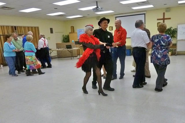 """Thunder Mountain Twirlers perform a square dance promenade. The group begins their """"ABC Fun Dance Program"""" teaching the basics of square dancing Oct. 25."""