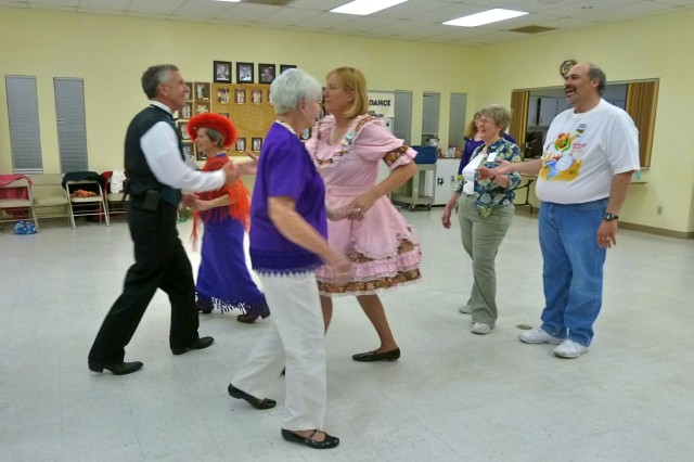 Thunder Mountain Twirlers perform a square dance in a single square formation. A single square contains eight dancers.
