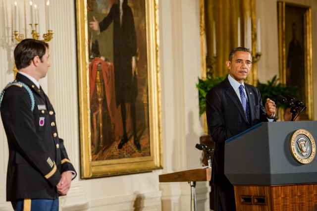 President Barack Obama speaks before awarding former Army Capt. William D. Swenson the Medal of Honor on October 15, 2013 at the East Room of the White House, Washington, D.C. (U.S. Army Photo by Sgt. Mikki L. Sprenkle/Released)