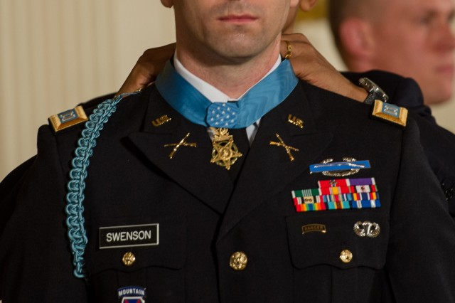 President Barack Obama awards the Medal of Honor to former Army Capt. William D. Swenson of Seattle, Wash., during a ceremony in the East Room at the White House in Washington, D.C. on October 15, 2013. (U.S. Army Photo by Sgt. Mikki L. Sprenkle/Released)