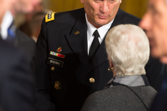 U.S. Army Chief of Staff Gen. Raymond T. Odierno speaks with family members of former Army Capt. William D. Swenson during a ceremony in the East Room at the White House in Washington, D.C. on October 15, 2013.  Swenson is being awarded the Medal of Honor for his actions in a lengthy battle against the Taliban insurgents in the Ganjgal Valley on September 8, 2009. (U.S. Army Photo by Sgt. Mikki L. Sprenkle/Released)