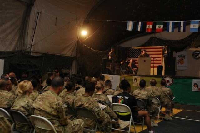 Col. Robert M. Villalobos, chief of staff for 1st Theater Sustainment Command, speaks during the National Hispanic Heritage celebration, Oct. 11, 2013, at Bagram Air Field, Parwan province, Afghanistan. This event hosted by Task Force Lifeliner, not only helps the Hispanic community to retain their traditions but also educates the Hispanic culture to other people from different nationalities. (U.S. Army photo by Sgt. Sinthia Rosario, Task Force Lifeliner Public Affairs)