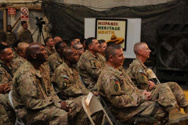 Service members celebrate National Hispanic Heritage, Oct. 11, 2013, at Bagram Air Field, Parwan province, Afghanistan. This event not only helps the Hispanic community to retain their traditions but also educates the Hispanic culture to other people from different nationalities. Task Force Lifeliner hosted this event. The guest speaker of the night was 1st Theater Sustainment Command Chief of Staff Col. Robert M. Villalobos was the guest speaker.  (U.S. Army photo by Sgt. Sinthia Rosario, Task Force Lifeliner Public Affairs)