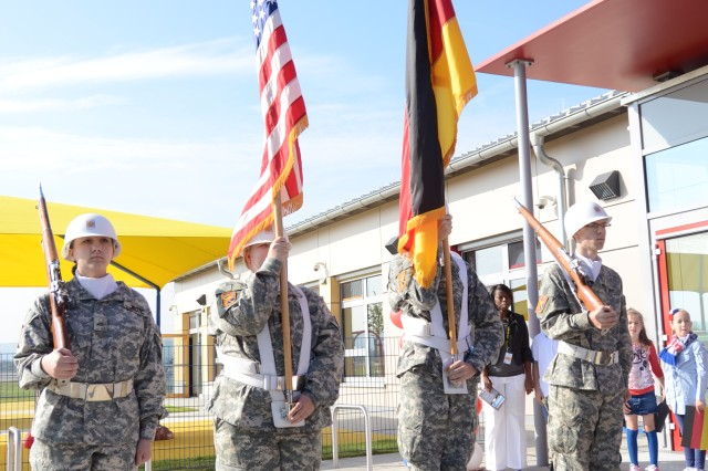 Members of the Junior ROTC color guard stand at attention at the start of the grand opening ceremony for the Storck Barracks Child, Youth and School Services Complex Sept. 28.