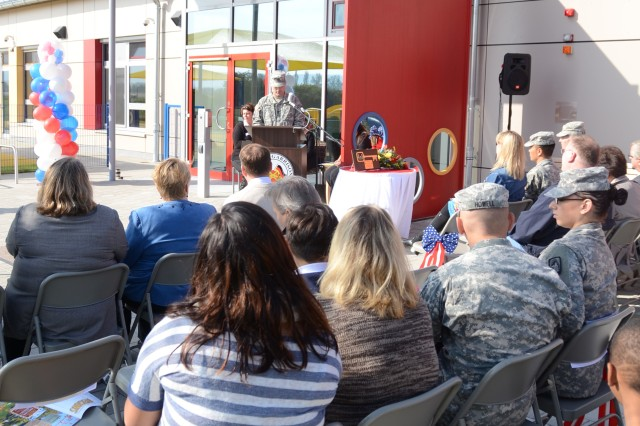 Members of the U.S. Army Garrison Ansbach community listen to Col. Christopher M. Benson, USAG Ansbach commander, as he speaks during the Storck Barracks Child, Youth and School Services Complex grand-opening ceremony Sept. 28.