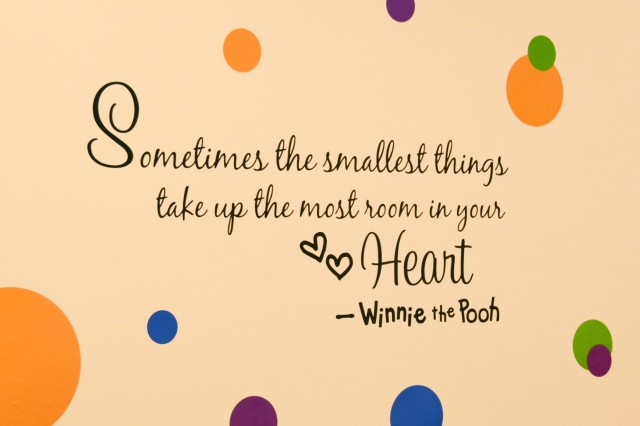"""A quote from Winnie the Pooh, """"Sometimes the smallest things take up the most room in your heart,"""" graces the interior wall of the new Storck Barracks Child, Youth and School Services Complex."""