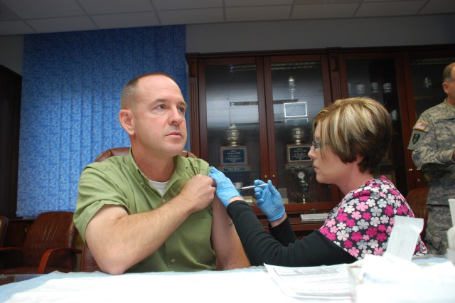 Amy Wilson, a registered nurse at Grafenwoehr Health Clinic, administers a seasonal flu vaccine to James Vaughn, deputy director of Emergency Services last year. As part of USAG Bavaria's Retiree Appreciation Day, Oct. 25, retirees will receive immunizations and various medical screenings.