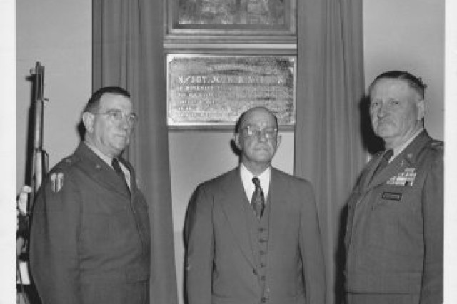 Brigadier Gen. Philip E. Gallagher, commanding general, Fort Holabird, Md., Joseph R. Wilson, father of Master Sgt. John R. Wilson, and Col. Henry C. Newton at the dedication ceremony of Wilson Hall, Fort Holabird, Md., on May 16, 1952.