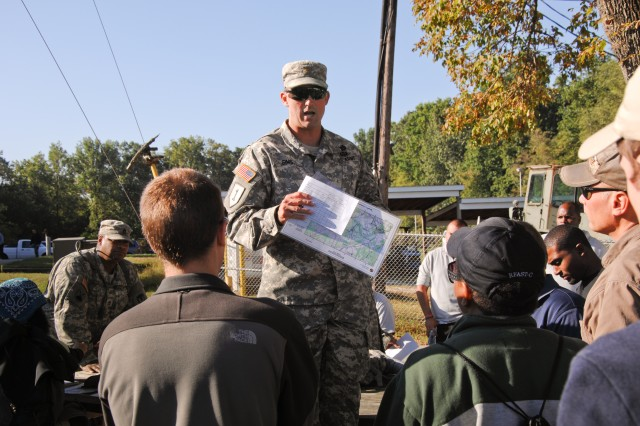 Maj. Shane Sims (center) talks with Army civilians before a land-navigation course at Gunpowder Military Reservation, Md., Sept. 19.