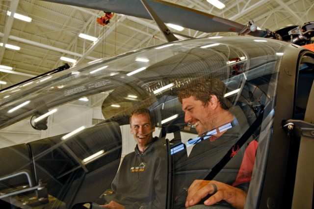 J.J. Kowal (left) and Walt Rada sit inside a LUH-72 Lakota at Aberdeen Proving Ground, Md., Sept. 25.
