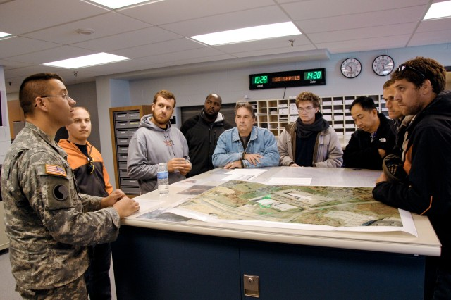 From left: Sgt. Matthew Woolmer briefs Joe Stevanak, Brad Stanley, Marlon Browne, Dan Paijean, Trevor Bart, Steve Huie, J.J. Kowal and Walt Rada at Aberdeen Proving Ground, Md., Sept. 25.