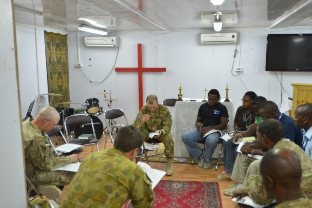 Chaplain (Capt.) Kevin Trimble, Task Force Gunfighter, 1st Combat Aviation Brigade, 1st Infantry Division, leads a bible study session, Sept. 19, 2013, for military and civilian personnel assigned to Multinational Base Tarin Kot, Afghanistan. (U.S. Army photo by Capt. Andrew Cochran/released)