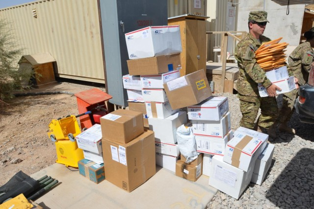 A stack of boxes, many of them donations from churches and soldier support organizations, awaits the members of Company E, 1st Attack Reconnaissance Battalion, 1st Aviation Regiment, at Multinational Base Tarin Kot, Afghanistan, Sept. 18, 2013. (U.S. Army photo by Capt. Andrew Cochran/released)