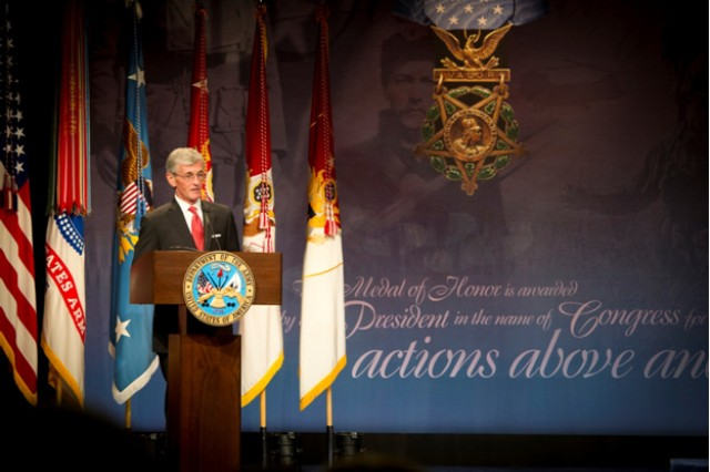 Secretary of the Army John McHugh delivers remarks during the Pentagon Hall of Heroes Induction Ceremony for Medal of Honor recipient former Capt. William D. Swenson, in the Pentagon, Oct. 16, 2013. In six hours of continuous fighting against more than 60 well-armed, well-positioned enemy fighters, Swenson braved intense enemy fire and willfully put his life in danger against the enemy's main effort, multiple times in service of his fallen and wounded comrades while serving as an Afghan Border Police advisor, in support of 1st Battalion, 32nd Infantry Regiment, 3rd Brigade Combat Team, 10th Mountain Division (Light Infantry), during combat operations in the Battle of Ganjgal, in Kunar Province, Afghanistan, Sept. 8, 2009. Swenson was presented the Medal of Honor by President Barack Obama, during a White House ceremony, Oct. 15, 2013.