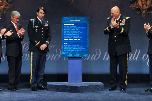 The names of 13 service members -- six living, seven posthumous -- who have received the Medal of Honor for their actions in Iraq or Afghanistan are inscribed in the Pentagon's Hall of Heroes as depicted by the above placard. Former Army Capt. William D. Swenson (third from left) was presented the Medal of Honor by President Barack Obama on Oct. 15 for going beyond the call of duty at the Battle of Ganjgal in Afghanistan, Sept. 8, 2009. Swenson was inducted into the Hall of Heroes, Oct. 16, 2013. Surrounding Swenson from left to right: Defense Secretary Chuck Hagel; Army Secretary John McHugh; Army Chief of Staff Gen. Ray Odierno and Sgt. Maj. of the Army Raymond F. Chandler III.