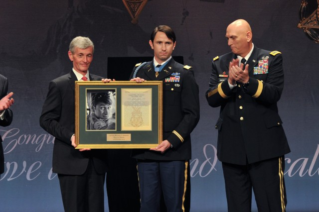 Secretary of the Army John McHugh presents William D. Swenson his framed Medal of Honor citation at a ceremony inducting the former Army captain into the Pentagon's Hall of Heroes, Oct. 16, 2013. Swenson was presented the Medal of Honor by President Barack Obama on Oct. 15 at the White House. Surrounding Swenson and McHugh are Defense Secretary Chuck Hagel, Army Chief of Staff Gen. Ray Odierno and Sgt. Maj. of the Army Raymond F. Chandler III.