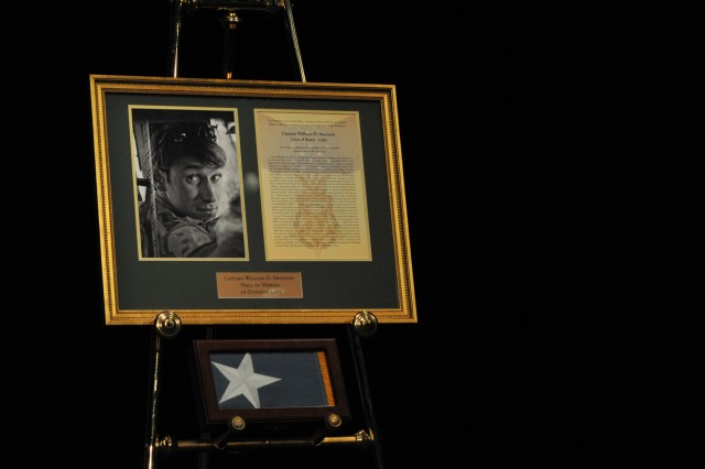 Former Army Capt. William D. Swenson's framed Medal of Honor citation and newly created personal MOH flag. Swenson was inducted into the Pentagon's Hall of Heroes, Oct. 16, 2013.