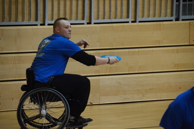 Sgt. Sam Frazier, Alpha Co., WTU, Wiesbaden, throws the Frisbee during an adaptive sports competition in Grafenwoehr, Oct. 15.