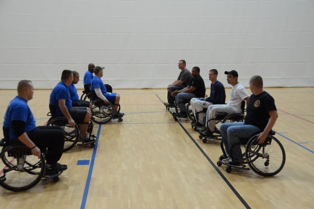 Alpha and Bravo companies face off during the start of a wheelchair Ultimate Frisbee game, Oct. 15.