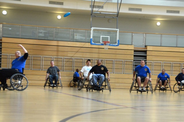 WTU Soldiers wheel their way across the court during a competitive game of wheelchair Ultimate Frisbee at the Grafenwoehr Physical Fitness Center, Oct. 15.