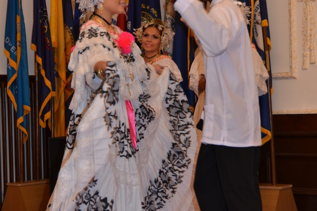 Melanie Putman and Brandon Hawell perform a traditional dance from Panama during the U.S. Army Garrison Ansbach Hispanic Heritage Observance Oct. 15.