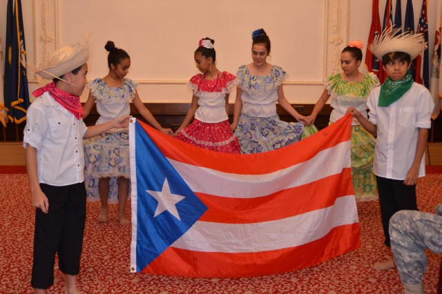 Young dancers perform a traditional dance from Puerto Rico during U.S. Army Garrison Ansbach's Hispanic Heritage Observance Oct. 15.