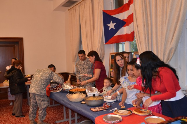 U.S. Army Garrison Ansbach community members get in line to taste the food samples provided by volunteers during the Hispanic Heritage Observance Oct. 15.