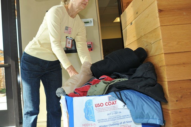 Debby Menarchik, USO volunteer, sorts through the coats donated to the USO-Metro, Heidi's Pantry and One Warm Coat 2nd Annual Coat and Clothing Drive at the USO Warrior and Family Center Oct. 15. Community members can donate coats and clothing at the USO or at The Villages at Belvoir community center through Oct. 26.