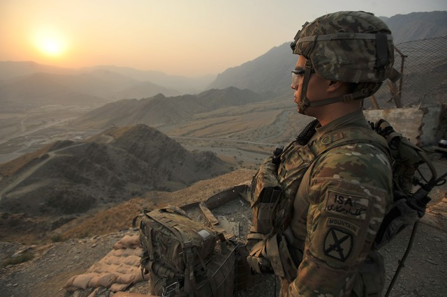 Spc. Dali Carrillo, who serves as an infantryman with 2nd Battalion, 30th Infantry Regiment, 4th Brigade Combat Team, 10th Mountain Division (LI), watches the sun rise before heading down the mountain after spending the night on an observation post Sept. 27 on Forward Operating Base Torkham, in Nangahar Province, Afghanistan.