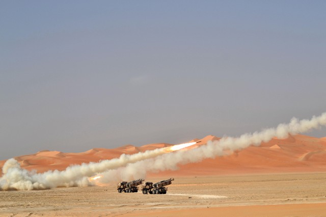 First Battalion, 14th Field Artillery Soldiers fire rockets from an M142 High Mobility Artillery Rocket System during a live-fire exercise, Oct. 1, 2013, with the host country unit, the 97th Heavy Artillery Regiment, in the United Arab Emirates. The 10-day exercise was the first-ever joint exercise with HIMARS involving U.S. forces in the UAE.