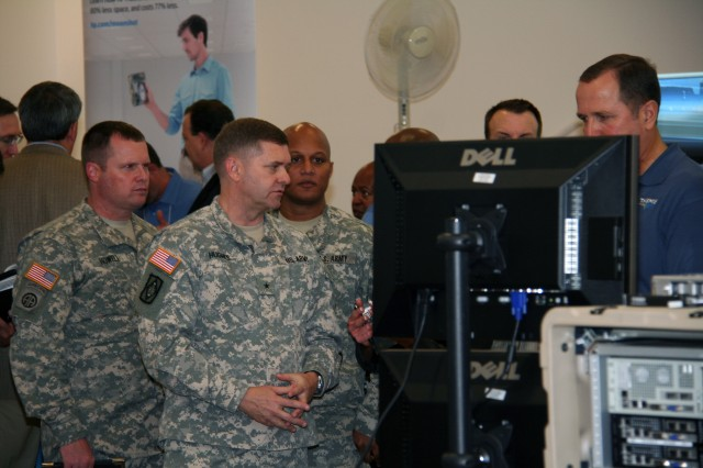 (From left to right) Maj. James Howell, executive officer for the Program Executive Office for Command, Control, and Communications-Tactical (PEO C3T); Brig. Gen. Daniel Hughes, program executive officer for C3T; and Lt. Col. Leonard Newman, product manager for Satellite Communications, observe emerging network technologies at the Common Hardware Systems Technology Day in October 2013, at Aberdeen Proving Ground, Md.