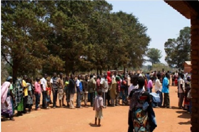 Patients await treatment outside the Muzgola medical clinic.  More than 2,300 patients were treated during the 10-day mission trip.