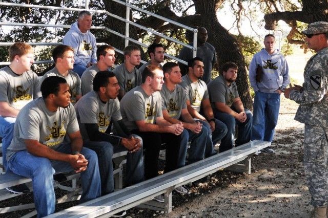 "Lt. Col. Archie Herndon, commander of the 2nd Brigade Special Troops Battalion, ""Spartans,"" 2nd Brigade Combat Team, 1st Cavalry Division, speaks with players from the Southwestern University football team, Georgetown, Texas, before the team begins maneuvering obstacles at the Leader's Reaction Course, here, Oct 9. Spartan soldiers hosted the event for the newly formed SU football team as a team-building exercise and leaders assessment for the team coaches."