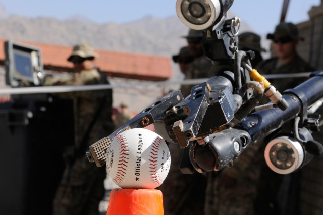 "KAPISA PROVINCE, Afghanistan "" A Soldier maneuvered a Talon Robot, designed to defeat improvised explosive devices, into position to gently picking up a baseball during Counter-IED training at Forward Operating Base Tagab, Oct. 15, 2013. Both the Soldier and robot belong to 2nd Battalion, 4th Infantry Regiment, 4th Brigade Combat Team, 10th Mountain Division, Task Force Patriot. (U.S. Army Photo by Sgt. Eric Provost, Task Force Patriot PAO)"