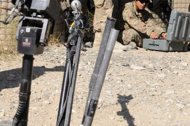 "KAPISA PROVINCE, Afghanistan "" Soldiers from, 2nd Battalion, 4th Infantry Regiment, learn the basics behind operating a Talon robot, a device designed to defeat improvised explosive devices, during Counter-IED training at Forward Operating Base Tagab, Oct. 15, 2013. 2nd Battalion is a part of 4th Brigade Combat Team, 10th Mountain Division, Task Force Patriot. (U.S. Army Photo by Sgt. Eric Provost, Task Force Patriot PAO)"