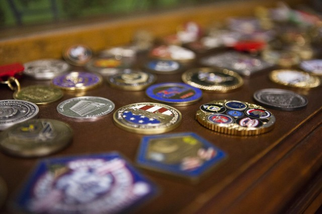 Brian Parker, Joint Base Myer-Henderson Hall public affairs specialist, has his challenge coins on display in his office Oct. 9, 2013.