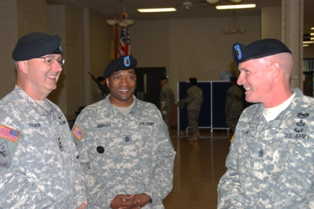 Lt. Gen. Michael Tucker, First Army commander, left, shares a lighter moment with Command Sgt. Maj. Jesse Andrews, center, and Command Sgt. Maj. Sam Young, right, prior to the change of responsibility ceremony held Friday at the Rock Island Arsenal's Heritage Hall.
