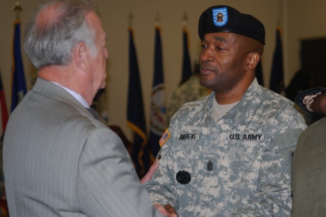 Davenport, Iowa Mayor Bill Gluba, left, wishes Command Sgt. Maj. Jesse Andrews farewell following the change of responsibility ceremony held Friday at the Rock Island Arsenal's Heritage Hall.
