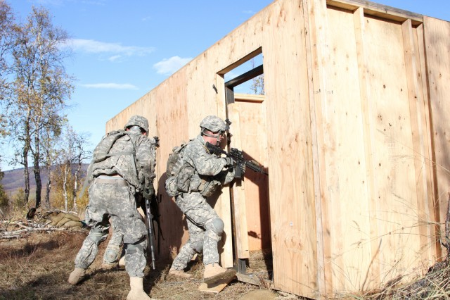 Soldiers from Company A, 1st Battalion, 21st Infantry Regiment, 1st Stryker Brigade Combat Team, 25th Infantry Division clear and secure a building during a platoon live fire exercise at Alaska's Yukon Training Area Sept. 27. (U.S. Army photo by Sgt. Michael Blalack, 1/25 SBCT Public Affairs)