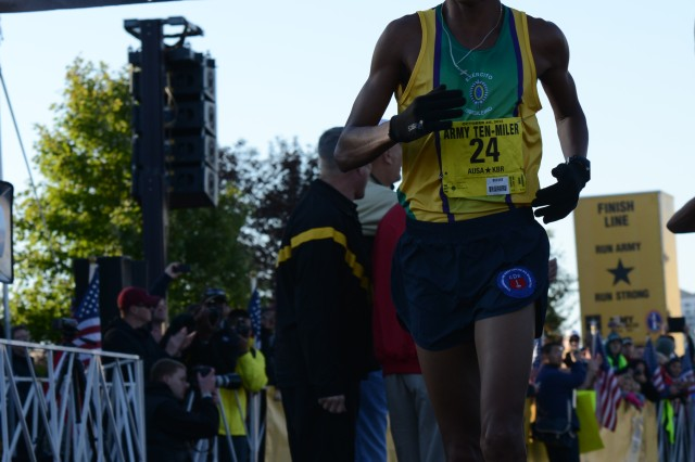 Solonei Silva, with the Brazilian Army team, crosses the finish line in first place in the Army Ten-Miler, Oct. 20, 2013.