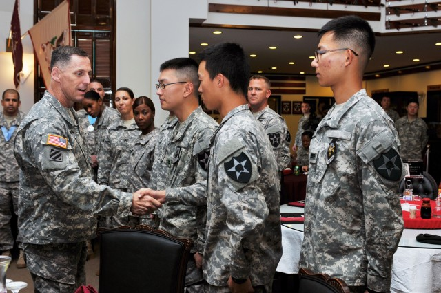 Three Korean Augmentation to the U.S. Army Soldiers received the Gen. Paik Sun Yup Leadership Award. Maj. Gen. Thomas S. Vandal, 2nd Inf. Div. commander shakes the inductee's hands and congratulates them on their success.