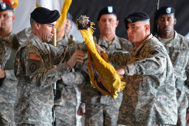The Commander of 4th Attack Reconnaissance Squadron, 6th Cavalry Regiment, Lt. Col. Brian Watkins, and the senior enlisted advisor to the commander,Command Sgt. Maj. Stanley Williams, uncase the unit's colors Oct. 18, 2013 at Camp Humphreys.