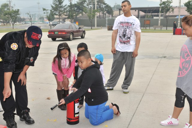 The Red Cross hosted a National Preparedness Month event for Soldiers and their Families at Camp Casey, in late September. Firefighters used the laser fire extinguisher to show the Soldiers and Families how to put out a fire.