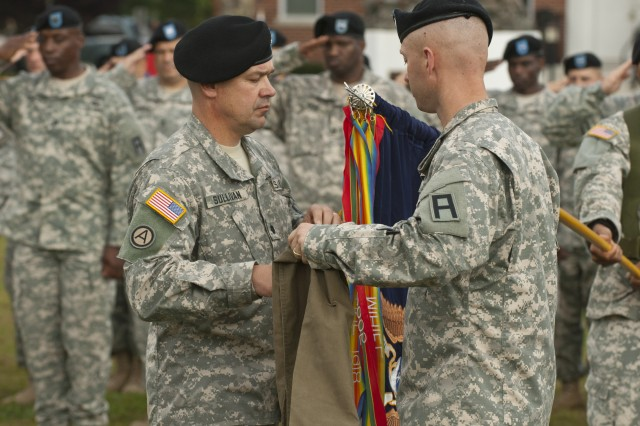 Lt. Col. Shawn Sullivan, left, and Command Sgt. Maj. Jamison Johnson, right, uncase the 2-312th Regiment's battalion colors as soldiers salute during a Transfer of Authority ceremony at Joint Base McGuire-Dix-Lakehurst, N.J., Oct. 17, 2013. The act signifies the transfer of mission from the outgoing 2-309th Regiment to the 2-312th, both U.S. Army Reserve units assigned to the Regular Army's 174th Infantry Brigade, First Army Division East. (U.S. Army photo by Sgt. 1st Class Stan Maszczak, 174th Infantry Brigade)