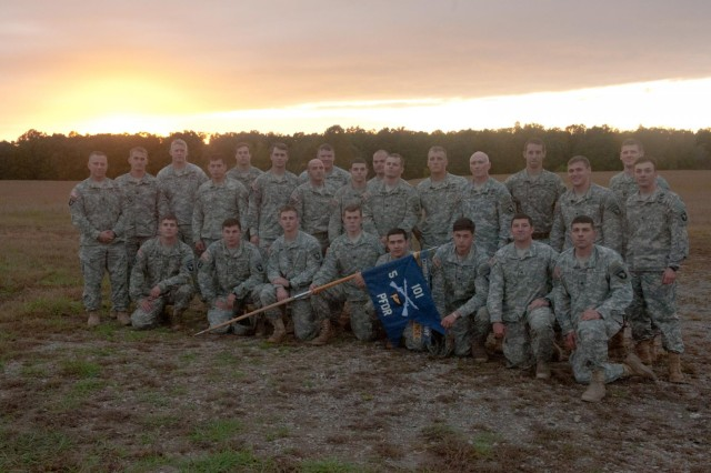 Soldiers from F Company, 5th Battalion, 101st Combat Aviation Brigade, 101st Airborne Division (Air Assault), Pathfinders, pose in front of a setting sun after completing the final jump for the Pathfinder company at Fort Campbell, Ky., Oct. 16, 2013. The Soldiers completed an airborne operation that was the last in the 101st Airborne Division's history.