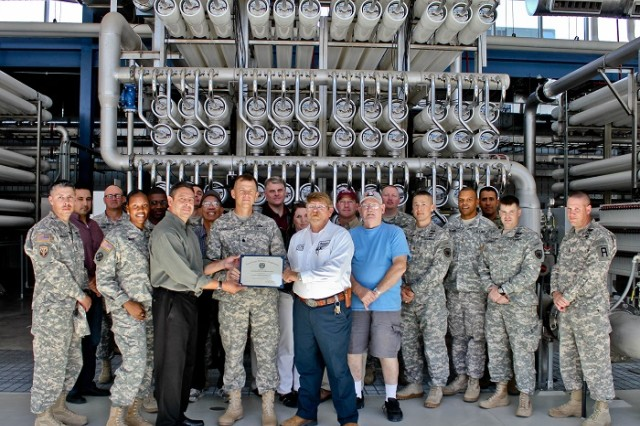 Lt. Col. Patrick Hogeboom, 1st Battalion, 361st Engineer Regiment, Task Force Redhawk, 5th Armored Brigade commander and president of the El Paso Society of American Military Engineers Post, presents Art Ruiz, Kay Bailey Hutchison Desalination Plant superintendent and Raymond Shay, Kay Bailey Hutchison Desalination Plant assistant superintendent, with a certificate of appreciation in El Paso, Texas, recently. Civilians in the El Paso Society of American Military Engineers Chapter and uniformed members of the 5th Armored Brigade, 1st Armored Division, William Beaumont Army Medical Center, and Joint Task Force North toured the world's largest inland desalination plant. (Photo by 1st Lt. Vanessa Dudley, 1st Battalion, 361st Regiment, Task Force Redhawk, 5th Armored Brigade, Division West Public Affairs)