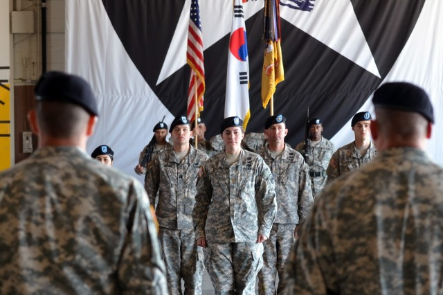 The Commander of 4th Attack Reconnaissance Squadron, 6th Cavalry Regiment, Lt. Col. Brian Watkins, and the senior enlisted advisor to the commander, Command Sgt. Maj. Stanley Williams, waits for the unit colors to be retired after the uncasing ceremony Oct. 18, 2013 at Camp Humphreys.
