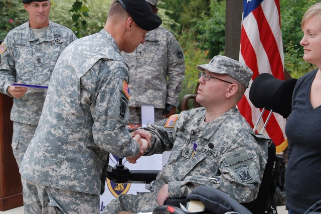 "FORT SAM HOUSTON, Texas - Maj. Gen. William Roy congratulates Staff Sgt. Edward Matayka after presenting the Purple Heart Medal to him Oct. 18 during a ceremony at the Warrior and Family Support Center. ""I decided that there was no one better than Maj. Gen. Roy to present my Purple Heart, and he was here (in San Antonio),"" Matayka said. ""I am deeply honored that (he) chose to do it."" Matayka, a combat medic, served with Company A, Special Troops Battalion, 86th Infantry Brigade Combat Team, Vermont National Guard, when he was wounded in July 2010. The brigade was commanded by (then Col.) Roy, who now serves as the deputy commanding general for U.S. Army North (Fifth Army)."